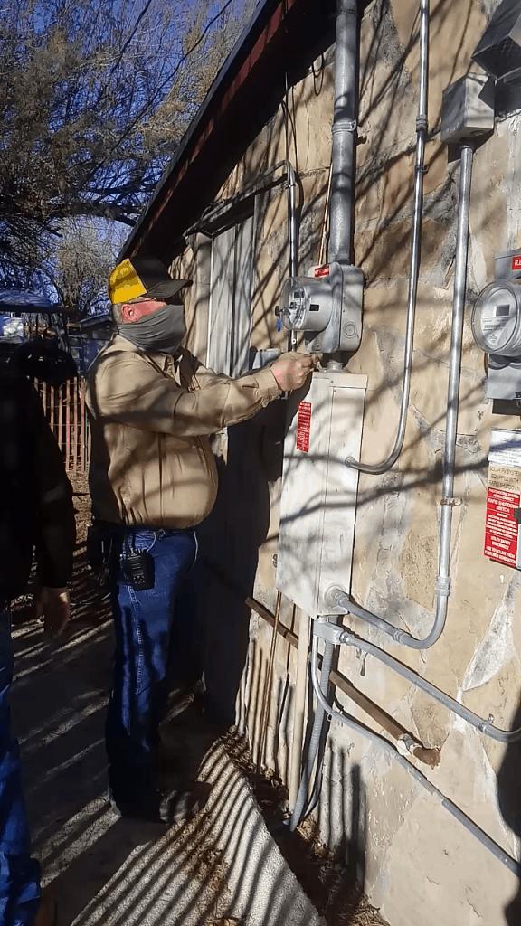Bo Easley restoring analog meter at Ron Fenn's home