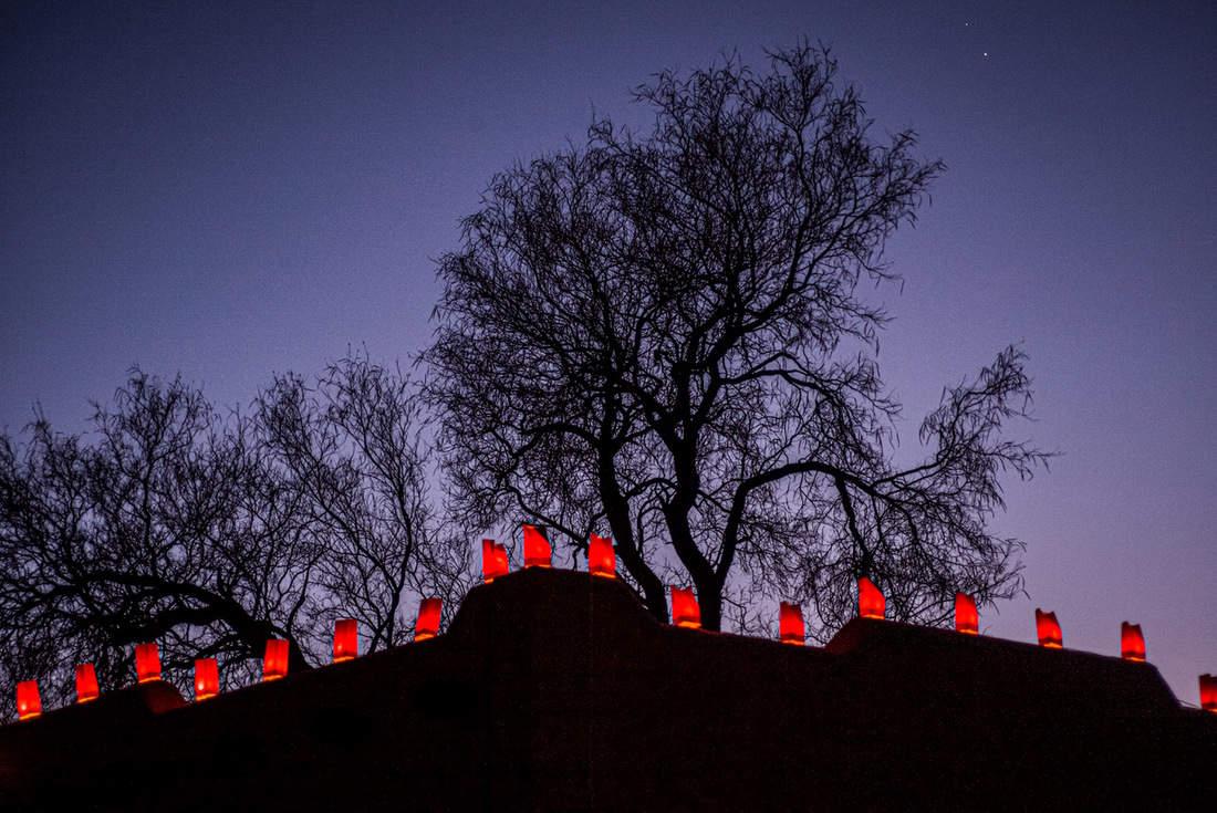 farolitas against a night sky