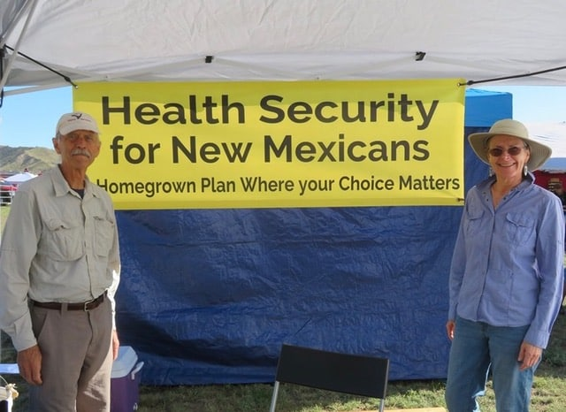 Veronique De Jaegher and her husband Bill Lindenau at Health Security Plan campaign booth