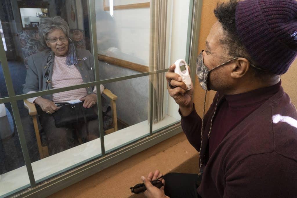 Rio Hamilton visits his mother at her nursing home