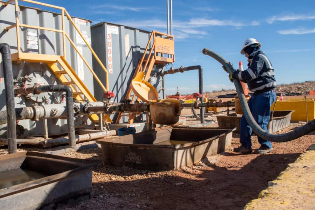 oil worker at a produced water treatement facility near Malaga, NM