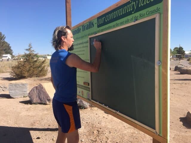 John Masterson at project chalk board in Rotary Park