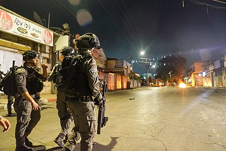 Israeli police upholding recent ceasefire on the streets of an Israeli city