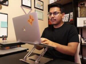 Luis Rios at his desk